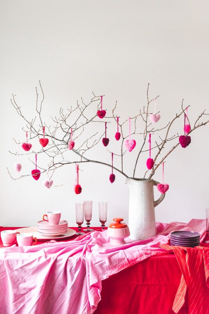 hanging heart pom poms from branches
