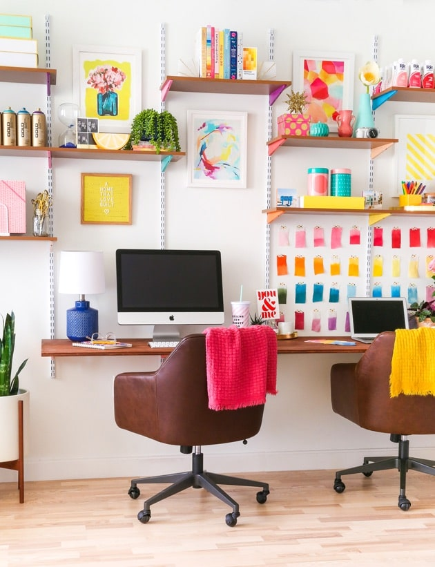 colourful fun workspace with 2 desks, wall storage