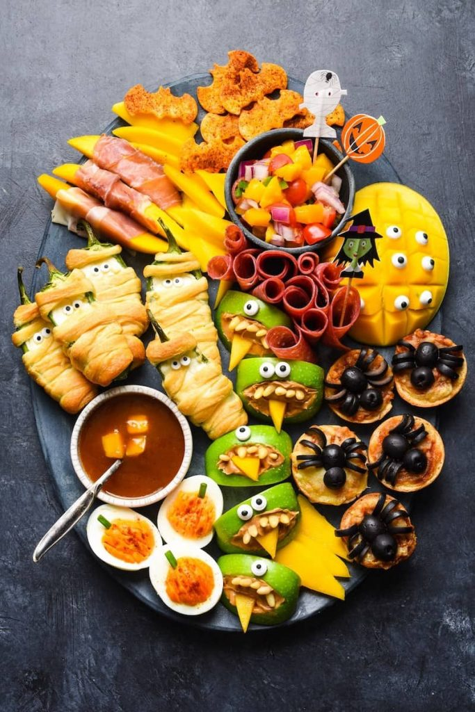 board of decorated Halloween party food