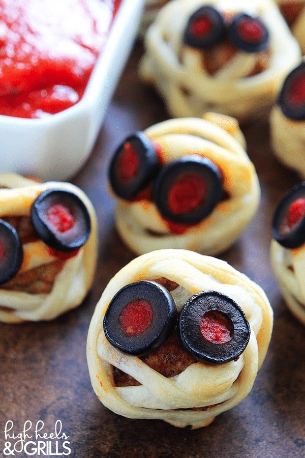 meatballs wrapped in pastry with mummy eyes