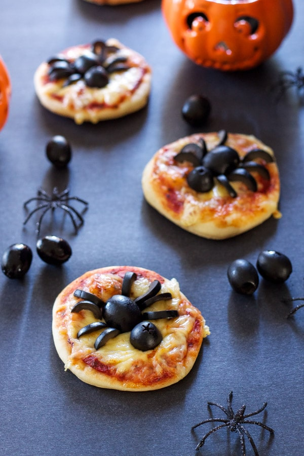olive spiders on mini pizza bases