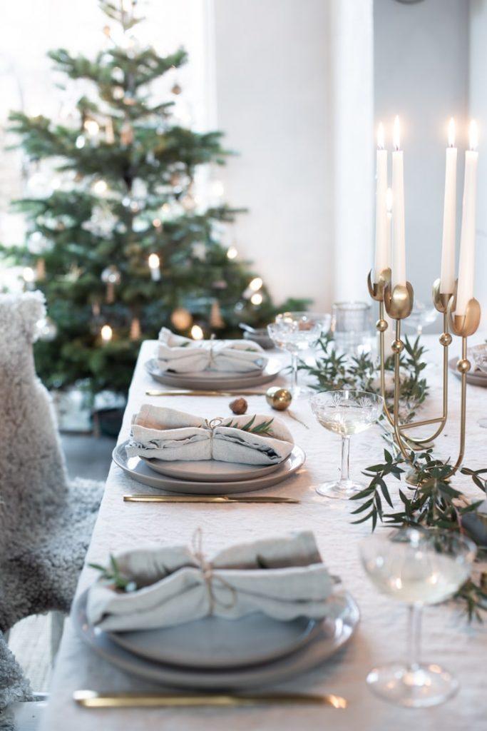 christmas table setting with candles and christmas tree