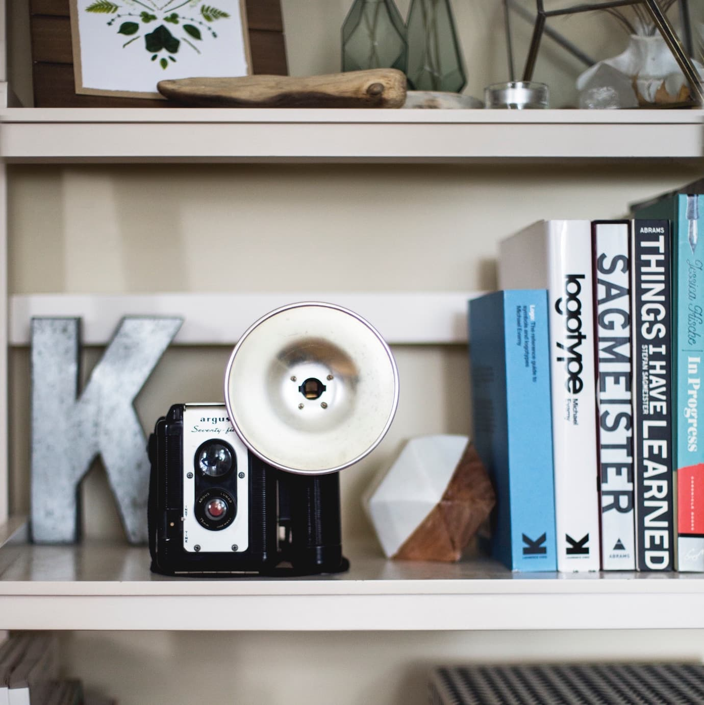 Create homey feel with books, decor and curios on shelving