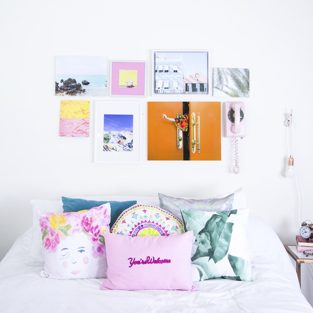 white teen girl bedroom with wall art and bright decor