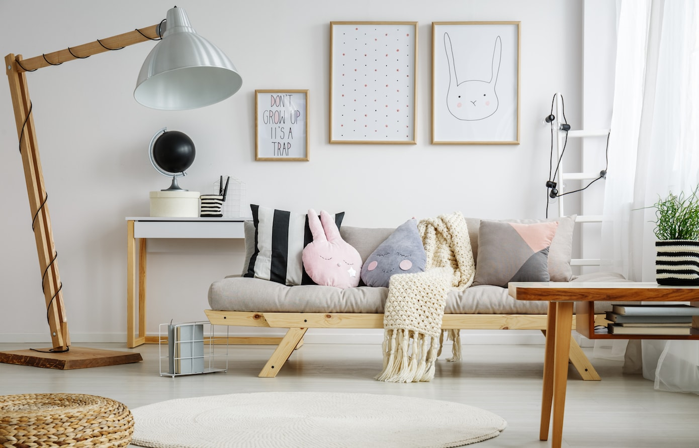 Scandi neutral kids living room with cute wall art