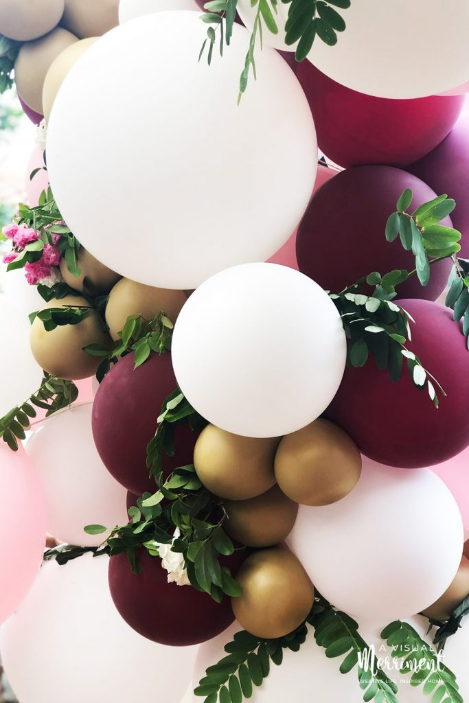 Close up of balloons and floral installation