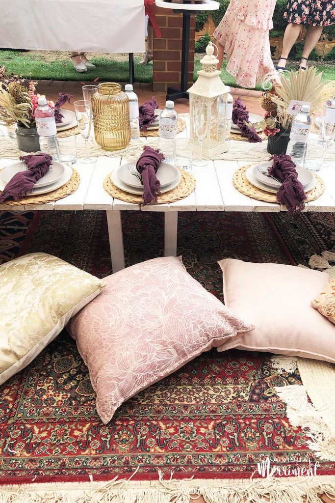 layered floor rugs and cushions at low bachelorette party table
