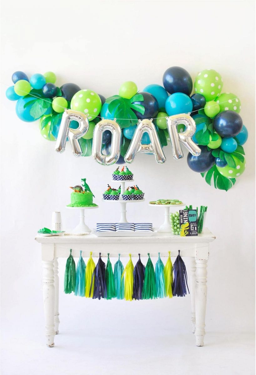 Green and blue dinosaur roar party buffet table