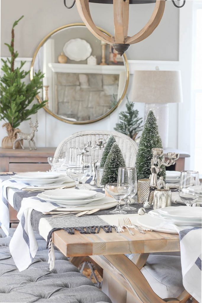 christmas table setting with trees and plaid blanket