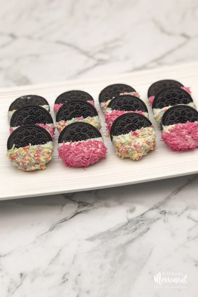 Platter of chocolate covered oreos on marble
