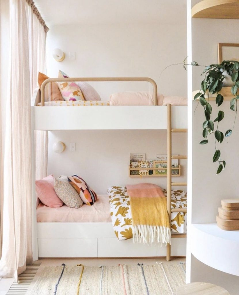 Neutral little girls room with bunk beds
