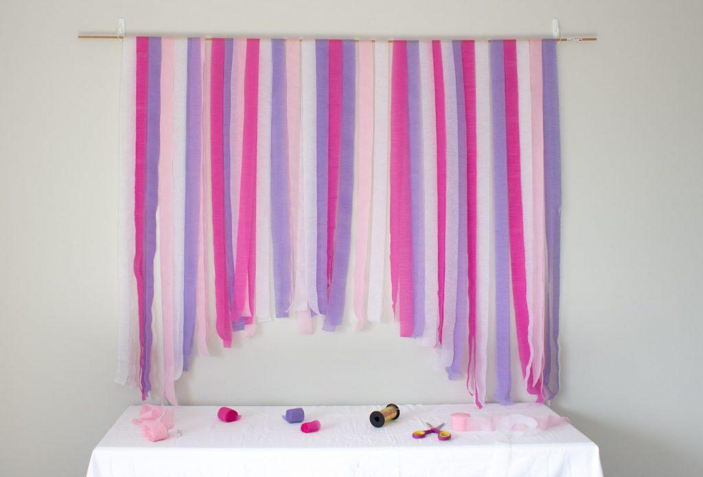Pink purple streamers on backdrop rod