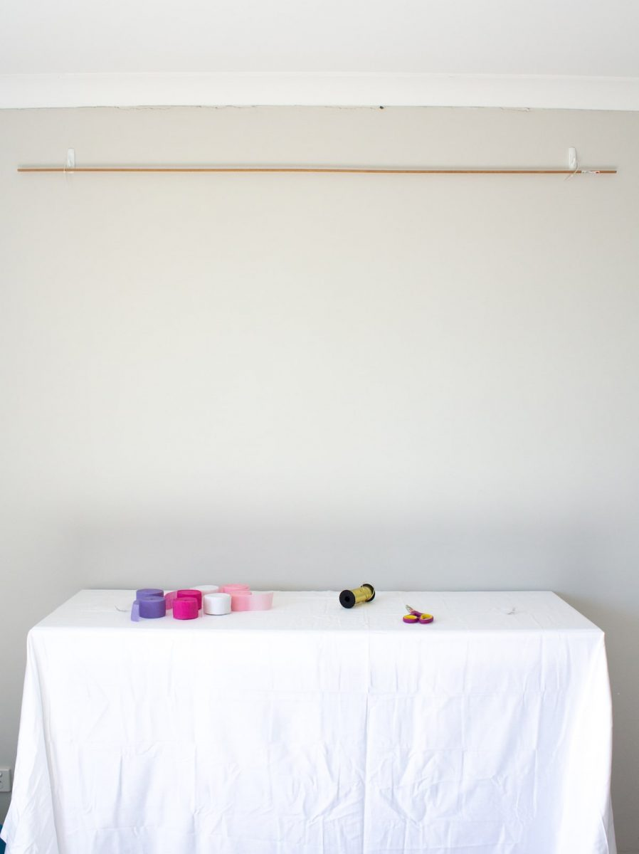 Hang backdrop rod to wall