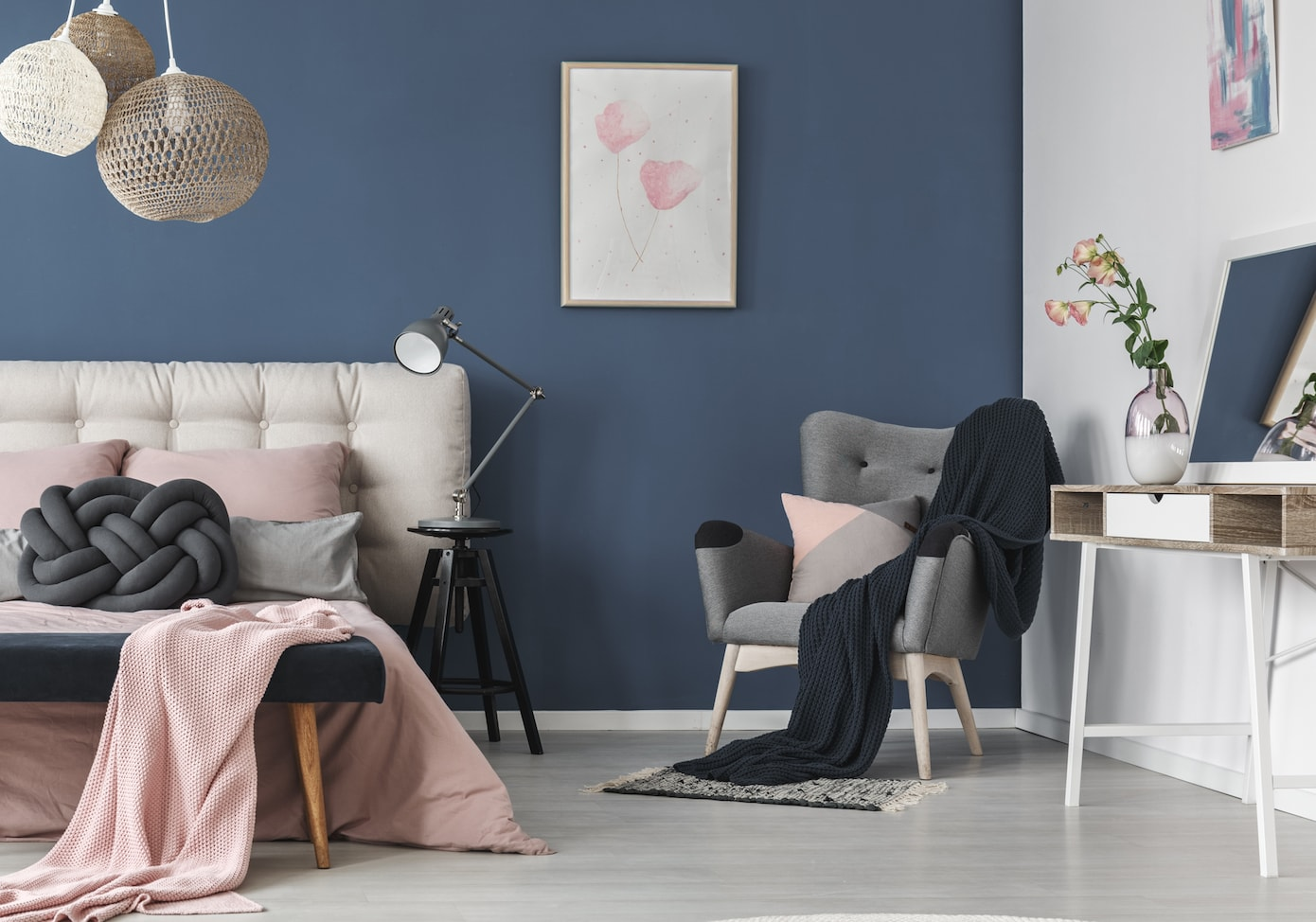 Navy blush pink scandi bedroom with knot cushion