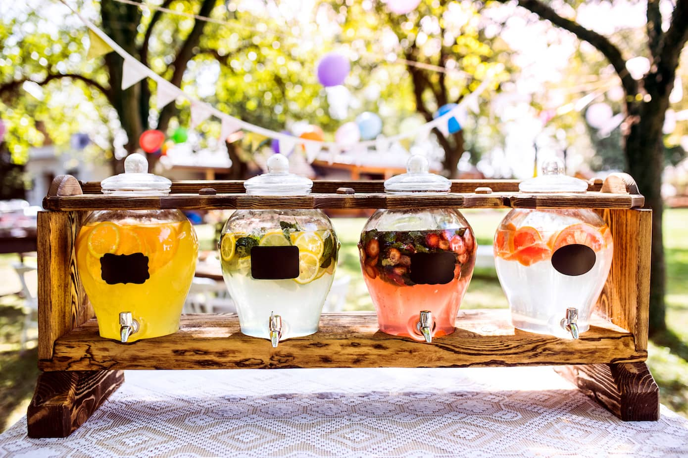 Party drinks served in glass dispensers at outdoor kids party