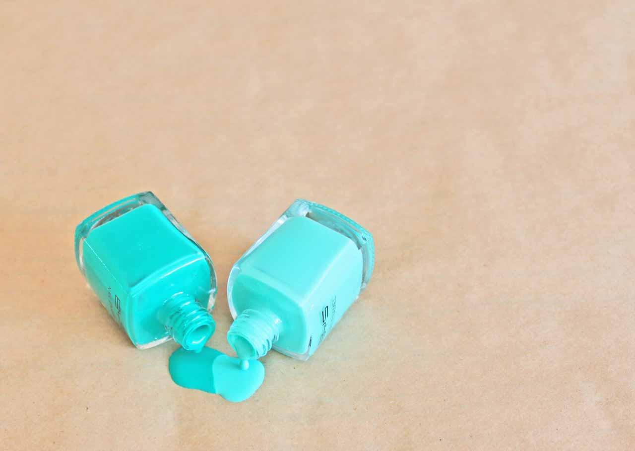 Green nail polish spill to make marble soap dispensers