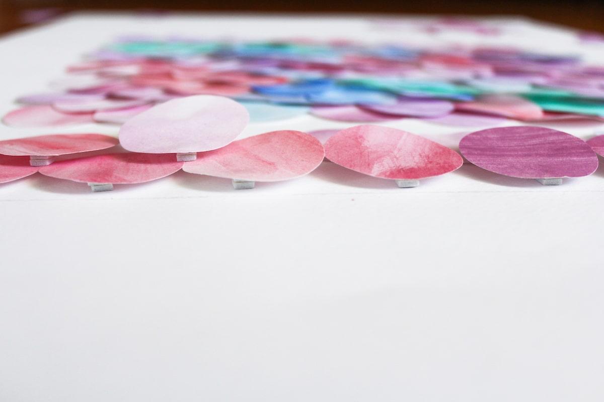 begin adhering 3d foam to watercolour paper disks