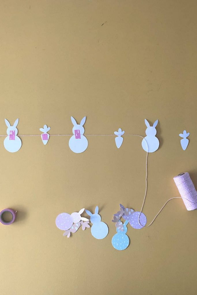 Washi tape attaching twine to paper shapes