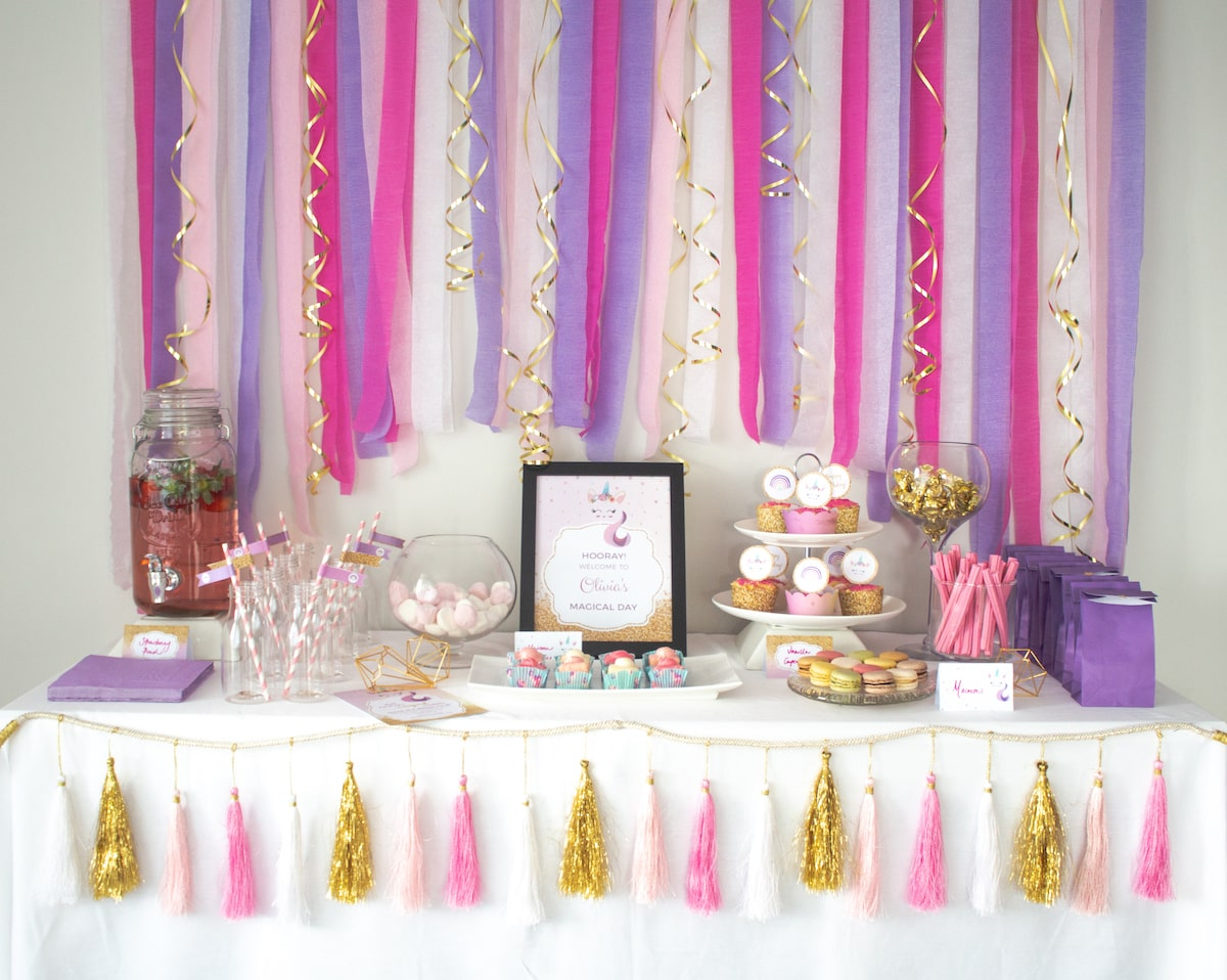 Front facing unicorn party buffet with backdrop