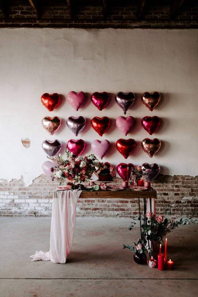 heart balloons against wall with buffet table