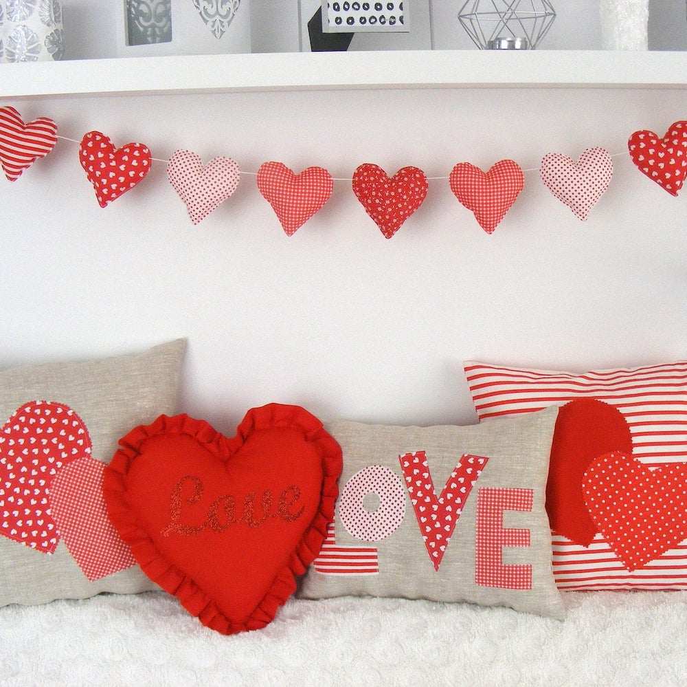 red valentines day decoration garland and pillows