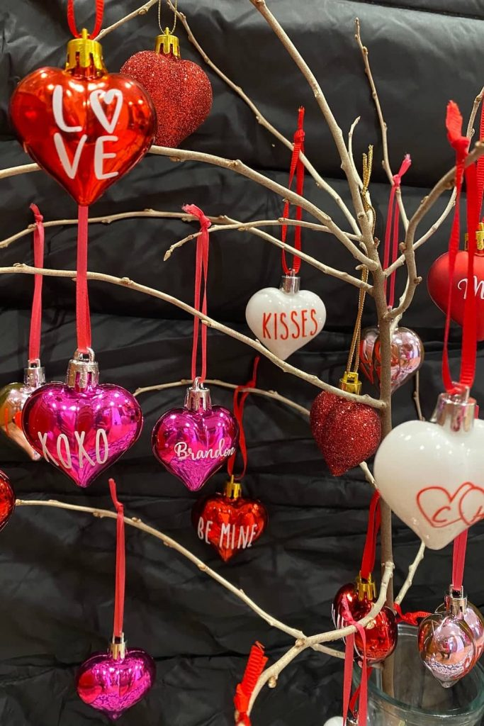 hanging valentines heart decorations on branches