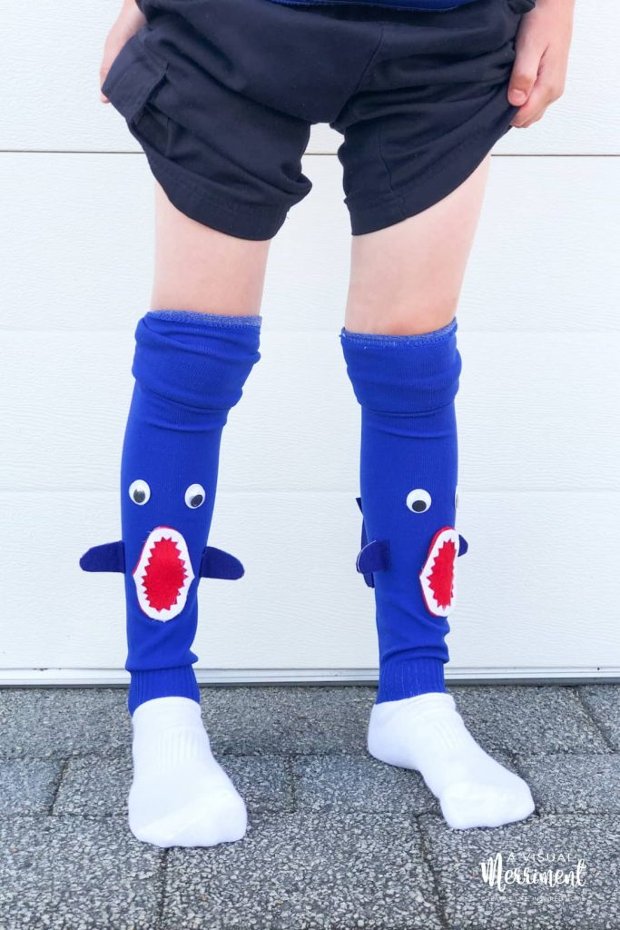 Boy wearing crazy socks, front view