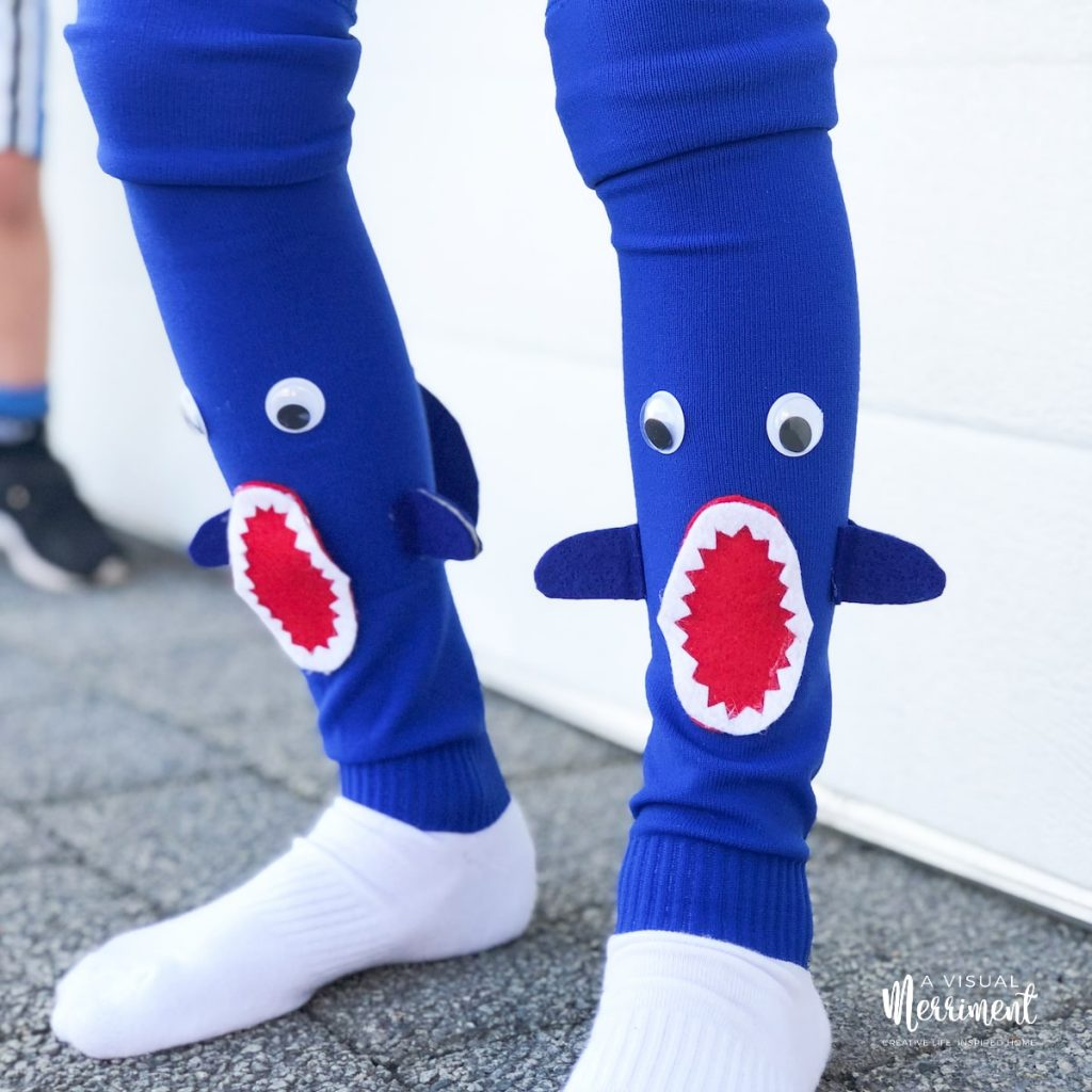 boy wearing crazy socks with fins
