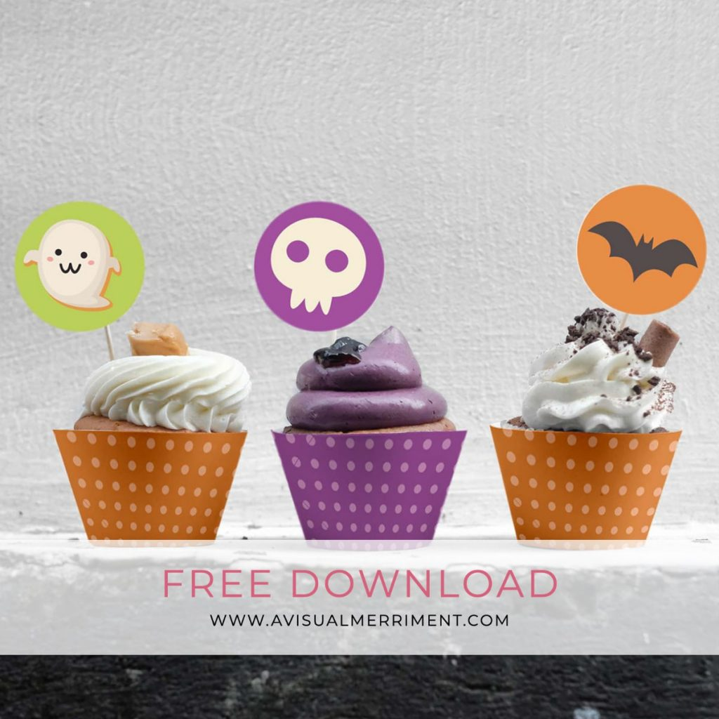 cupcakes decorated with halloween toppers and wrappers