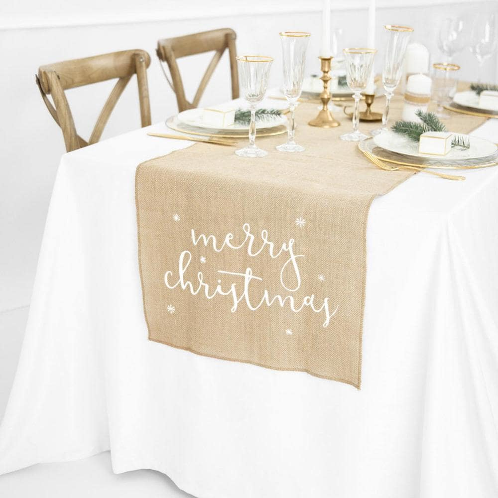 Burlap Christmas table runner on table with gold dinnerware