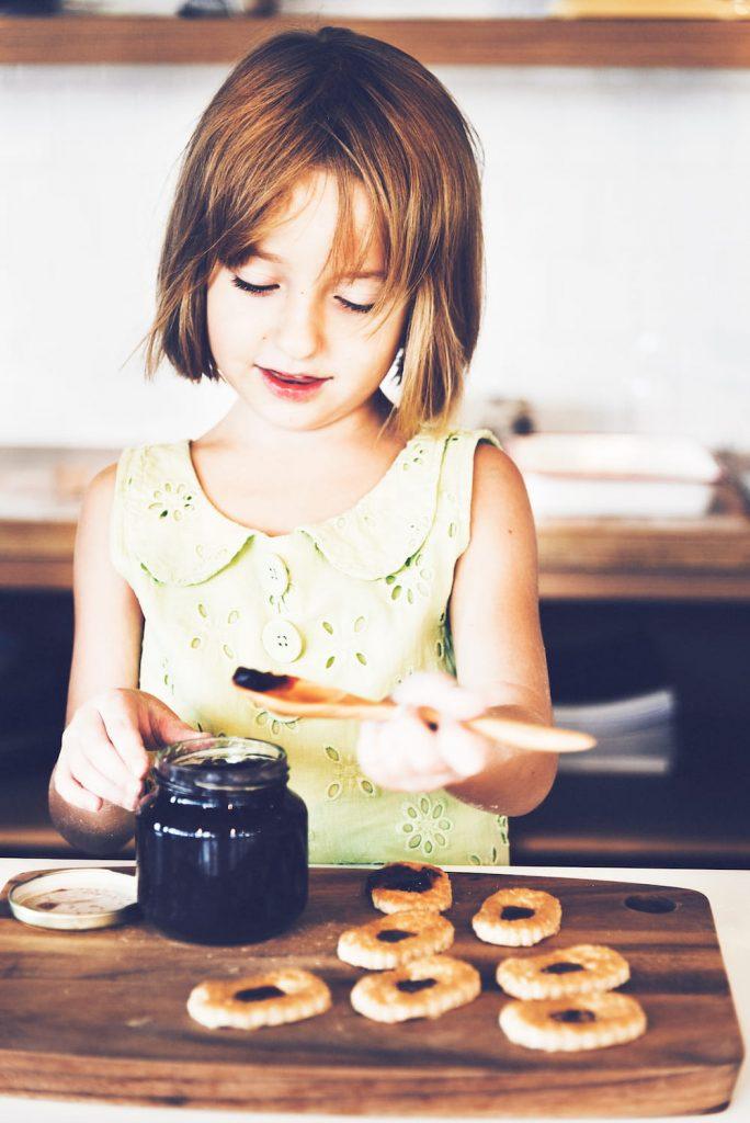 girl making jam pastries