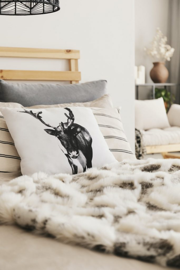 deer cushion on winter bed