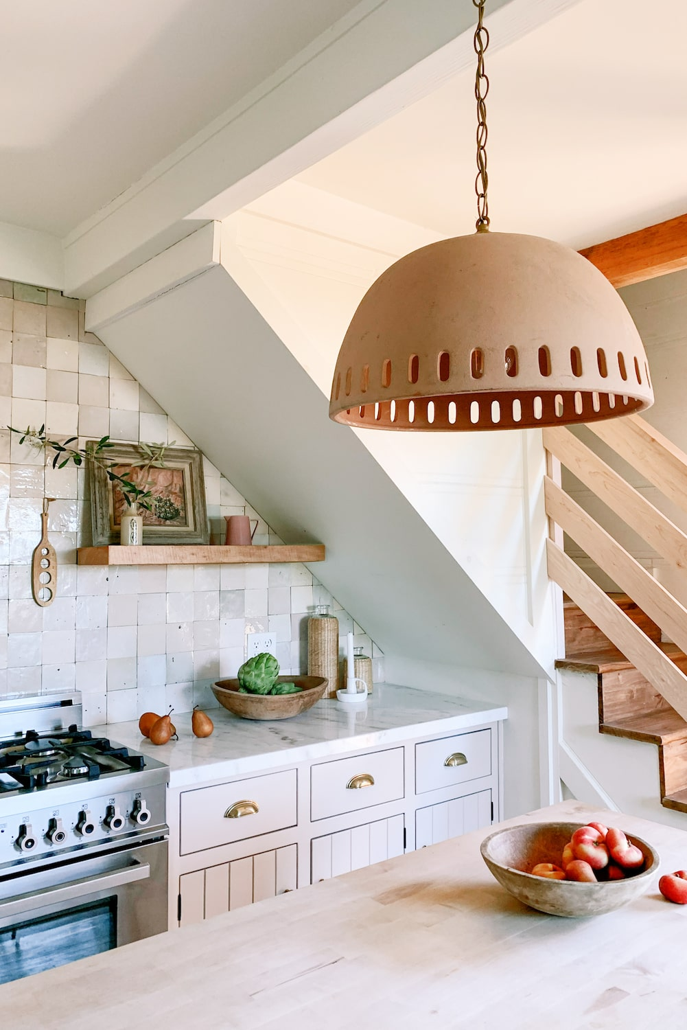 Rustic kitchen bench and lighting with tiled splash back