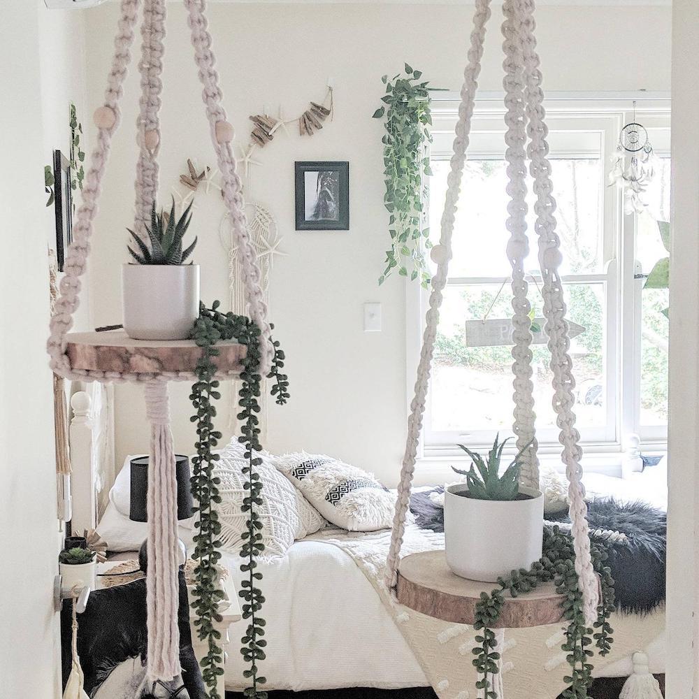 plants hanging on macrame shelves in bedroom