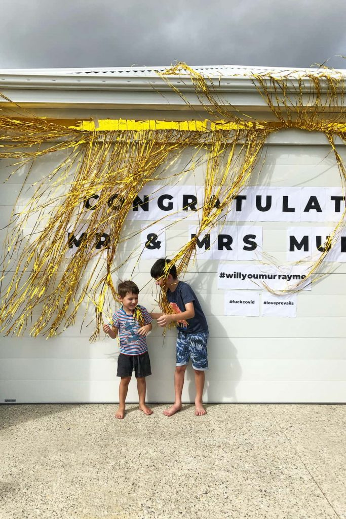 two boys in front of decorated garage
