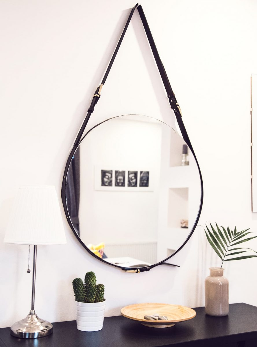 Round hanging mirror over hall stand decor