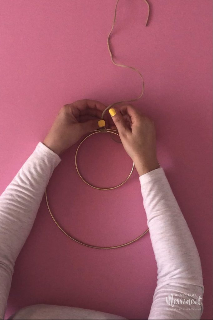 Looping cord around gold hoops