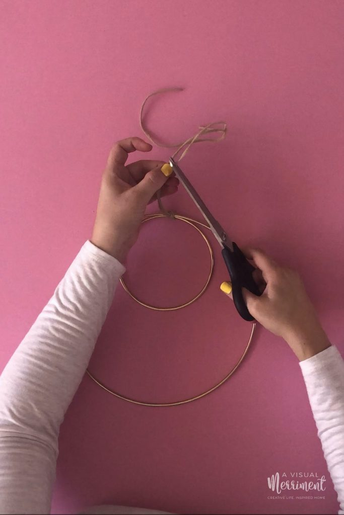 Cutting excess cord with scissors