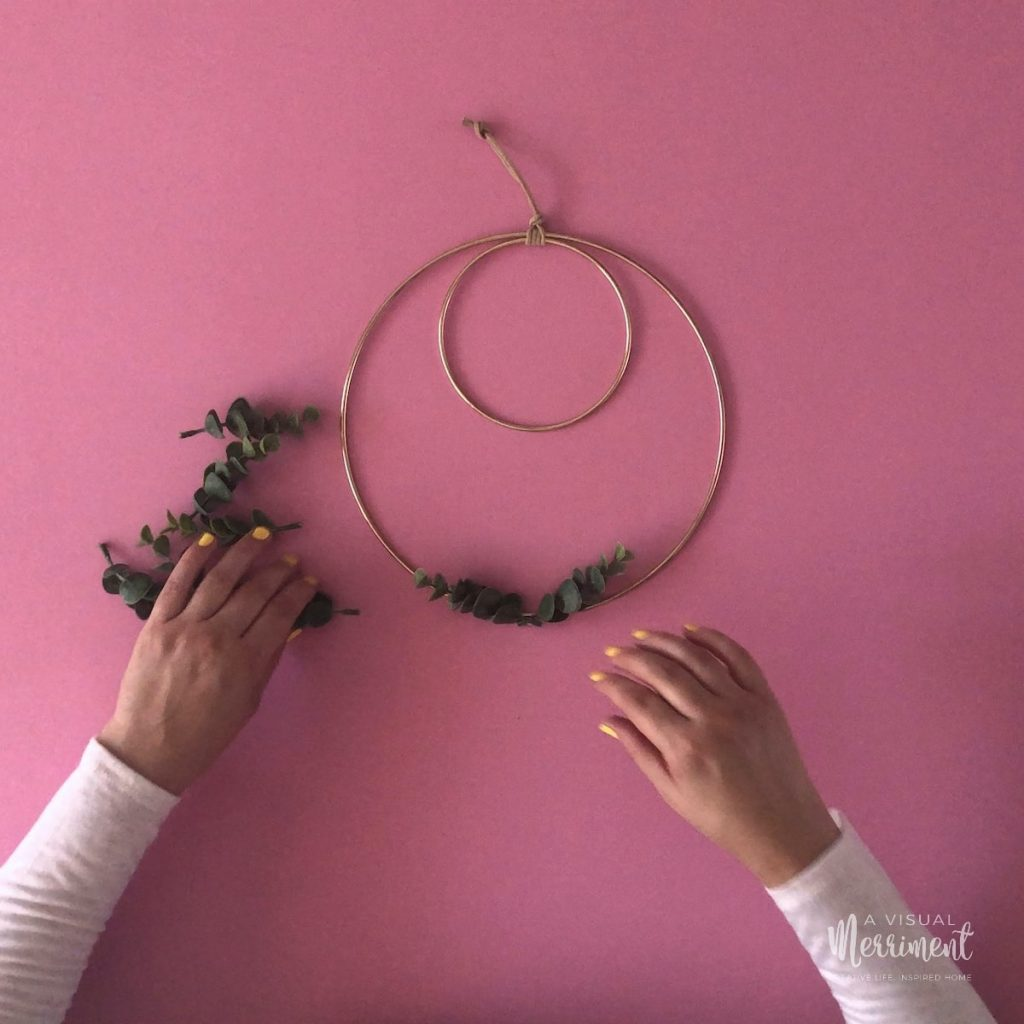 Two leaf branches centred on hoop wreath