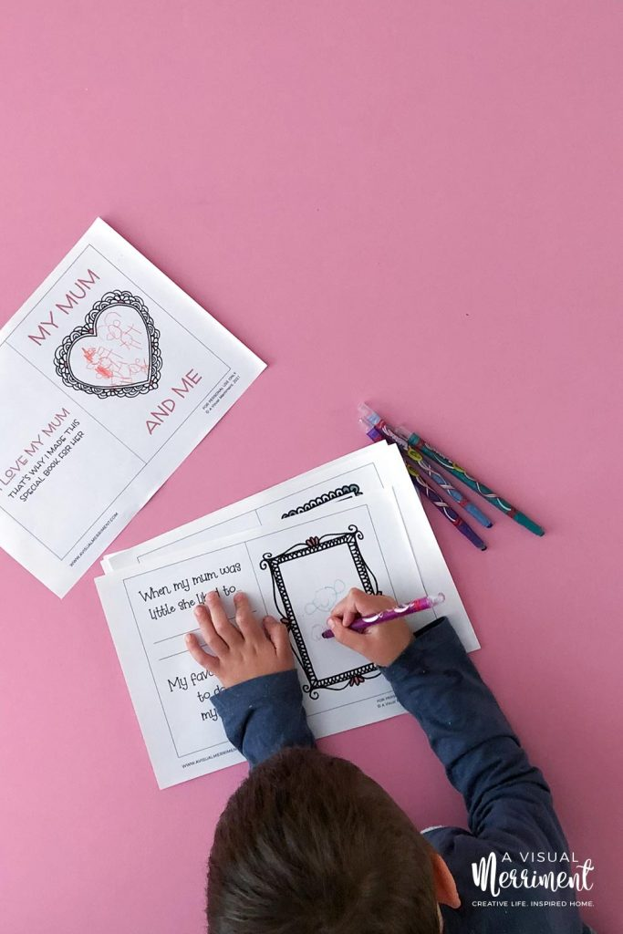 boy drawing pictures in printable book