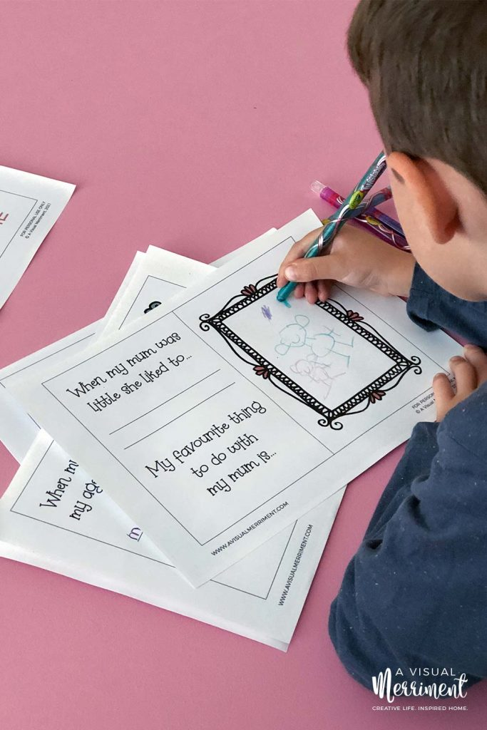 boy drawing pictures in mum and me printable book