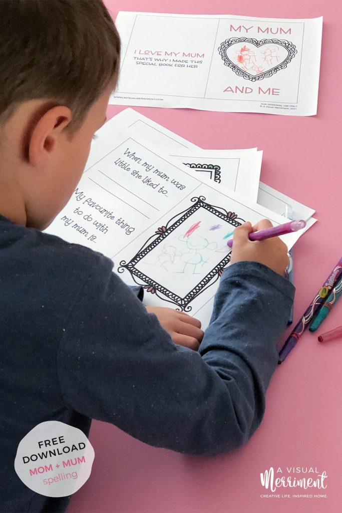 boy drawing picture of mum in printable book with crayons