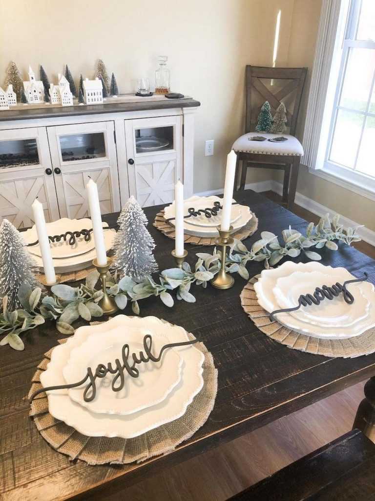 plates with christmas saying place cards set on decorated table
