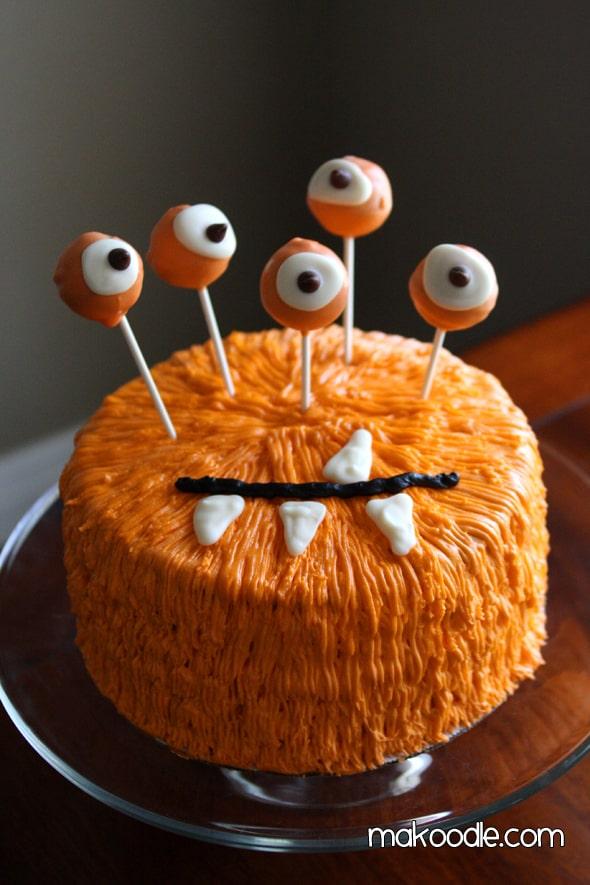 orange monster halloween cake with eyeballs