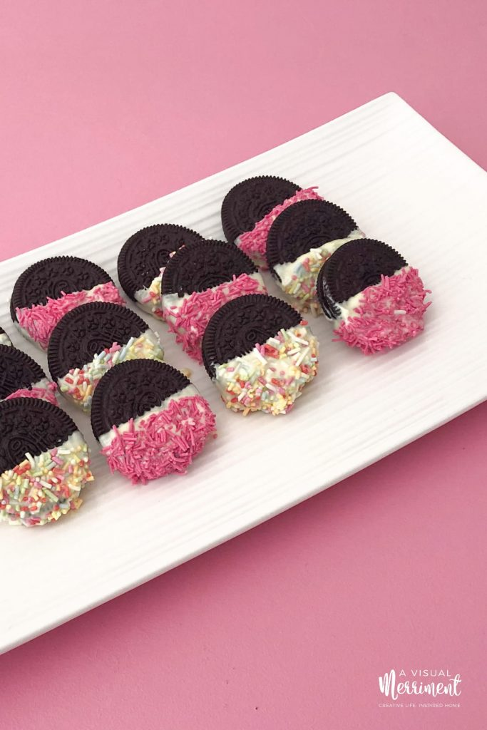 Chocolate covered oreos on white platter