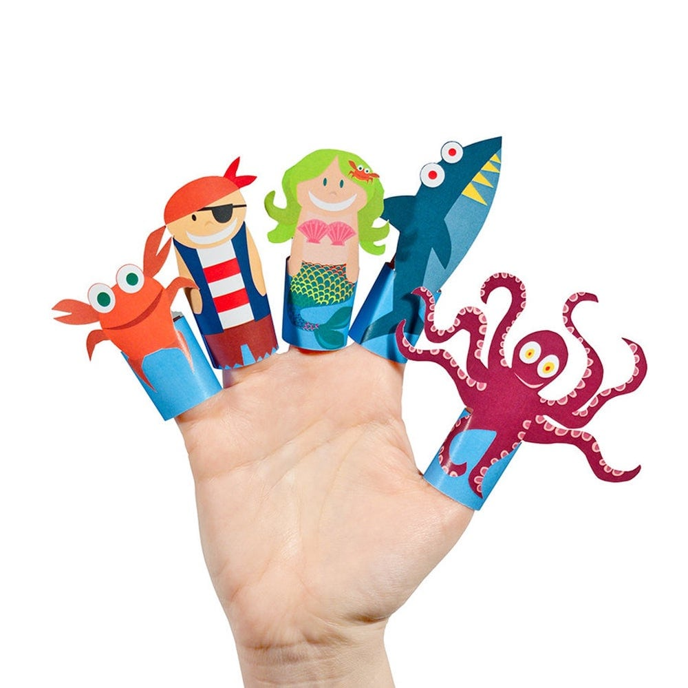 child's hand with paper puppets