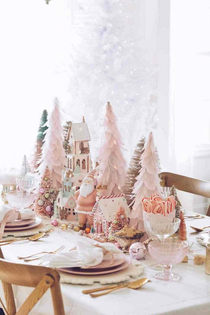 pink themed christmas table setting with trees and decor