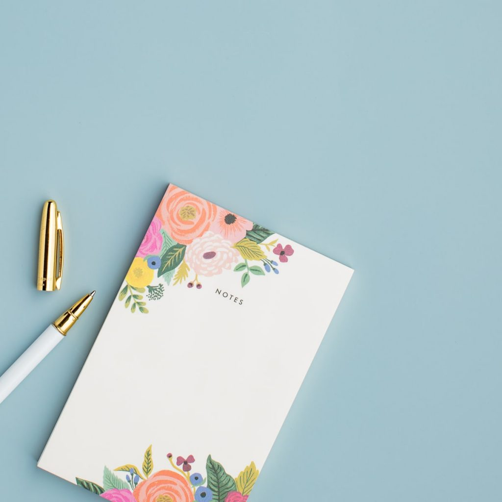 pen and floral notebook planner