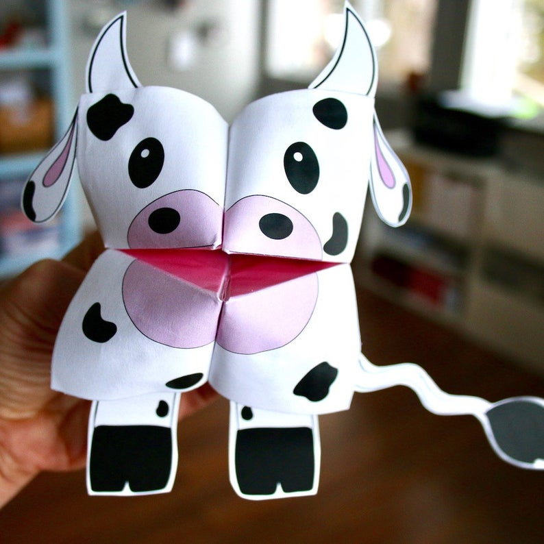 hand holding paper cow origami