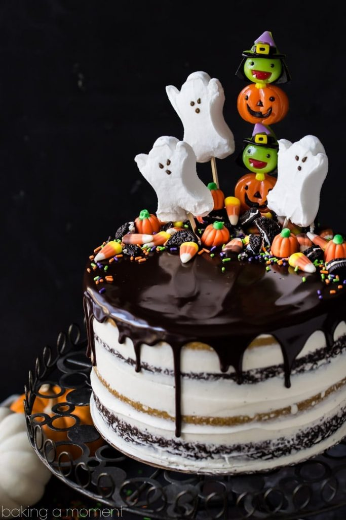 ghost, pumpkin and witch decorated halloween cake